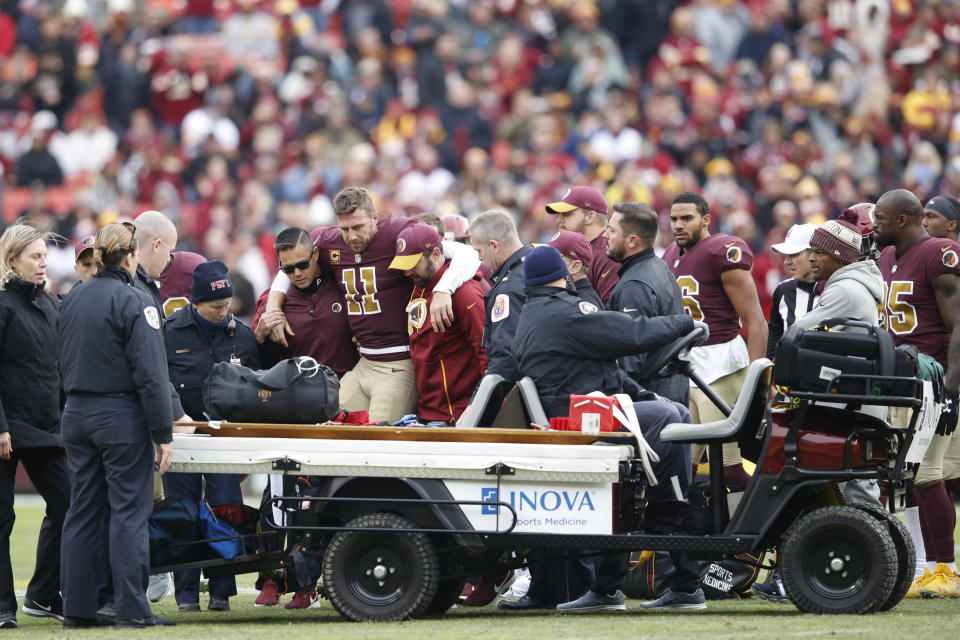 Alex Smith suffered a brutal broken leg in Sunday's loss to Houston. Perhaps his only consolation is that he had quite a financial safety net in the form of $71 million. (Getty Images)