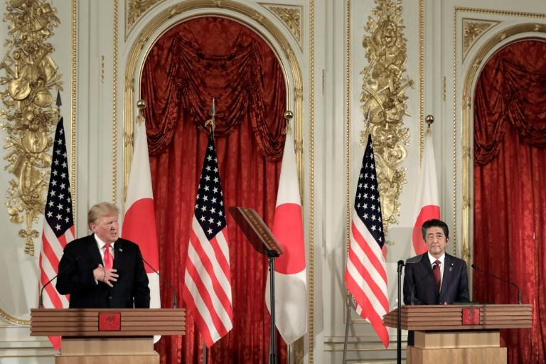 President Donald Trump and Prime Minister Shinzo Abe emphasised their friendship in Tokyo - part of Japan's strategy to deal with the rule-breaking US leader