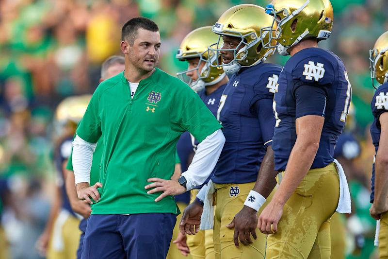SOUTH BEND, IN - SEPTEMBER 01: Notre Dame Fighting Irish quarterbacks coach Tommy Rees talks to Notre Dame Fighting Irish quarterback Brandon Wimbush (7) during warm ups prior to game action of the NCAA football game between the Michigan Wolverines and the Notre Dame Fighting Irish on September 1, 2018 at Notre Dame Stadium, in South Bend, Indiana. The Notre Dame Fighting Irish defeated the Michigan Wolverines by the score of 24-17. (Photo by Robin Alam/Icon Sportswire via Getty Images)