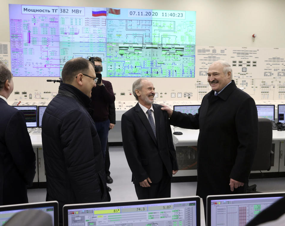 """Belarusian President Alexander Lukashenko, right, attends the first Belarusian Nuclear Power Plant during the plant's power launch event outside the city of Astravets, Belarus, Saturday, Nov. 7, 2020. Alexander Lukashenko on Saturday formally opened the country's first nuclear power plant, a project sharply criticized by neighboring Lithuania. Lukashenko said the launch of the Russian-built and -financed Astravyets plant """"will serve as an impetus for attracting the most advanced technologies to the country. and innovative directions in science and education."""" (Nikolai Petrov/BelTA Pool Photo via AP)"""