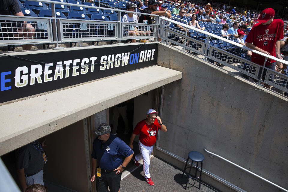 North Carolina State head Coach Elliott Avent exits the locker room during a delay due to COVID-19 safety protocols before their baseball game against Vanderbilt at the College World Series Friday, June 25, 2021, at TD Ameritrade Park in Omaha, Neb. (AP Photo/Rebecca S. Gratz)