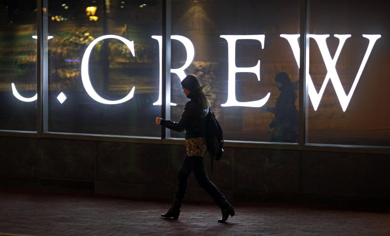 In this April 15, 2013 picture, a woman walks past a J. Crew retail store in Baltimore. Americans increased their spending in April at retail businesses, buying more cars and clothes after cutting purchases sharply in March. The rebound suggests consumers may help boost growth again in the April-June quarter(AP Photo/Patrick Semansky)