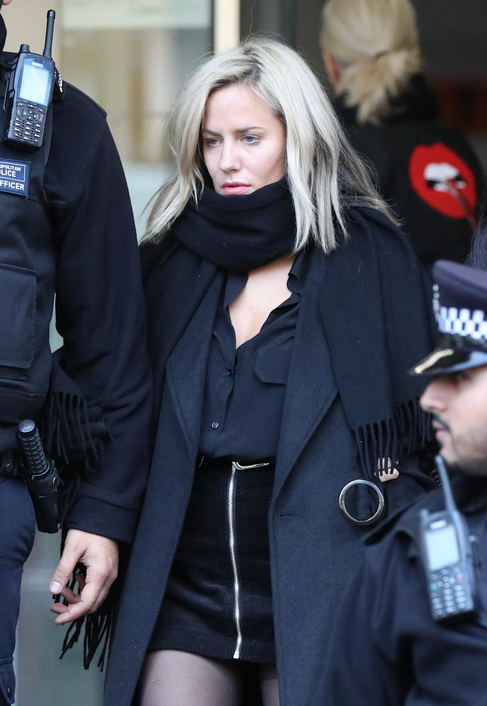 Caroline Flack leaving Highbury Corner Magistrates' Court after she had pleaded not guilty to assaulting boyfriend Lewis Burton last year. (PA)