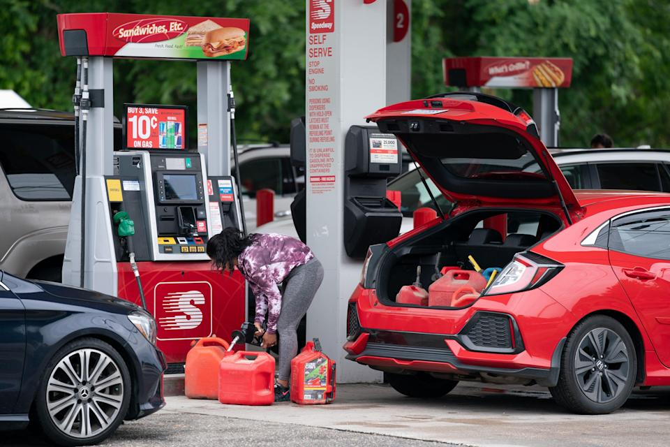 A woman fills gas cans at a Speedway gas station on May 12 in Benson, N.C. Most stations in the area along I-95 are without fuel after the Colonial Pipeline hack.
