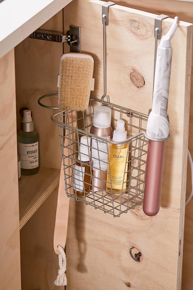 """<p>We love that this <a href=""""https://www.popsugar.com/buy/Over--Cabinet-Organizer-Basket-466599?p_name=Over-The-Cabinet%20Organizer%20Basket&retailer=urbanoutfitters.com&pid=466599&price=24&evar1=casa%3Aus&evar9=47087273&evar98=https%3A%2F%2Fwww.popsugar.com%2Fhome%2Fphoto-gallery%2F47087273%2Fimage%2F47089328%2FOver--Cabinet-Hair-Tool-Organizer-Basket&list1=shopping%2Corganization%2Chome%20organization&prop13=mobile&pdata=1"""" rel=""""nofollow"""" data-shoppable-link=""""1"""" target=""""_blank"""" class=""""ga-track"""" data-ga-category=""""Related"""" data-ga-label=""""https://www.urbanoutfitters.com/shop/over-the-cabinet-hair-tool-organizer-basket?category=SEARCHRESULTS&amp;color=007"""" data-ga-action=""""In-Line Links"""">Over-The-Cabinet Organizer Basket</a> ($24) can hold so many different types of hair tools. </p>"""