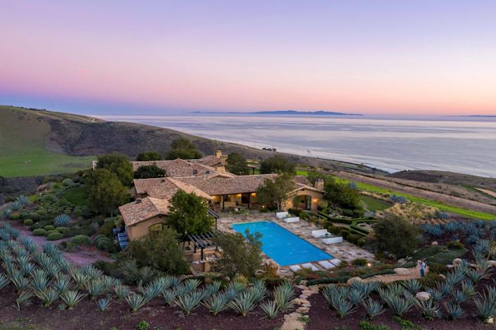 """Located on the Gaviota Coast overlooking the ocean, El Rancho Tajiguas is a sustainable property comprising two villas, both LEED certified. Villa Della Costa, at 10,300 square feet, has five bedrooms, heated floors, swimming pool, pool cabana, movie theater, wine cellar, and guest house. The 12,000-square-foot Villa Del Mare also has five bedrooms, swimming pool, movie theater, wine cellar, and guest house. El Rancho's 3,500 acres of grounds include active cattle rangeland, fruit orchards, and swaths of untouched landscape.<br> <br> Price: $110 million <br> Beds/Baths: The ranch includes Villa Della Costa, which has 5 bedrooms and 11 bathrooms, and Villa Del Mare, which has 5 bedrooms and 10 bathrooms. <br> Square Footage: Villa Della Costa is 10,300 and Villa Del Mare is 12,000. The property is on 3,500 acres of land. <br> For more information, please click <a href=""""https://www.ranchotajiguas.com/"""" rel=""""nofollow noopener"""" target=""""_blank"""" data-ylk=""""slk:here"""" class=""""link rapid-noclick-resp"""">here</a>."""