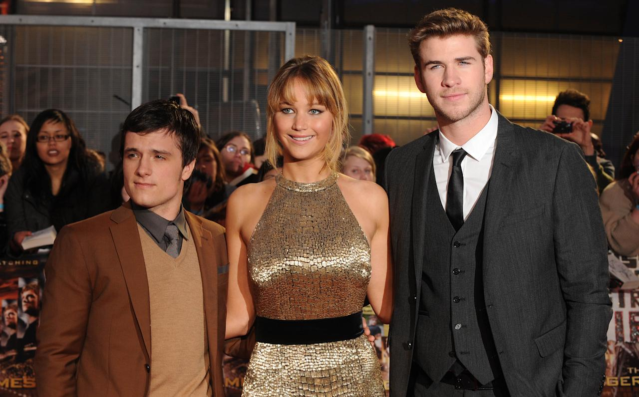 LONDON, UNITED KINGDOM - MARCH 14: Josh Hutcherson, Jennifer Lawrence and Liam Hemsworth attend the European premiere of The Hunger Games at O2 Arena on March 14, 2012 in London, England. (Photo by Stuart Wilson/Getty Images)