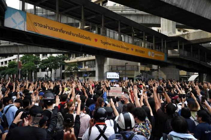 FILE PHOTO: Pro-democracy protesters show the three-finger salute as they gather demanding the government to resign and to release detained leaders in Bangkok