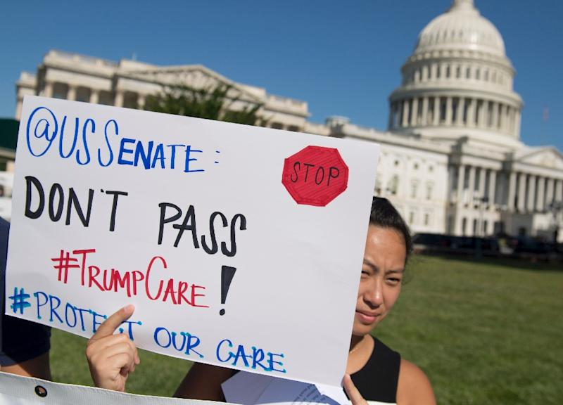 President Donald Trump's health care reform, the subject of frequent protests, is one of the pending issues forcing the US Senate to delay its summer break (AFP Photo/SAUL LOEB)
