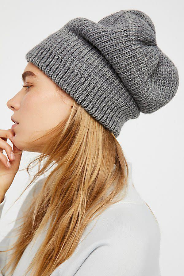 There's so much room in this <span>beanie</span> to either tuck in your hair or keep it full and out without flattening out your texture.