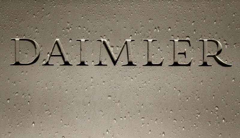 FILE PHOTO: Daimler AG sign with raindrops is pictured before the company's 2016 annual news conference in Stuttgart