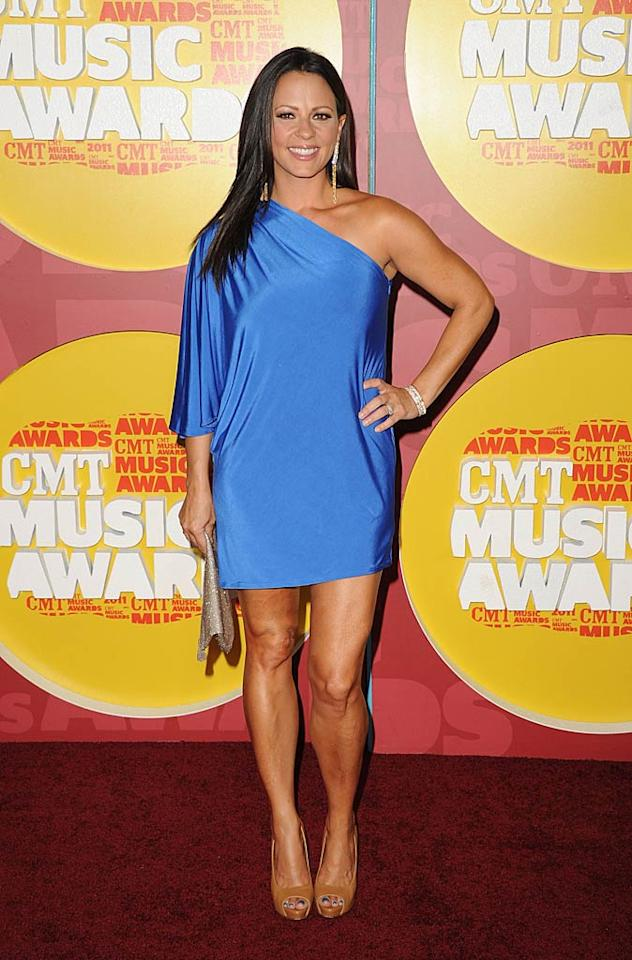 "Sara Evans made the mistake of sporting an unshapely, one-shouldered mini and matching electric blue nail polish. Jason Merritt/<a href=""http://www.gettyimages.com/"" target=""new"">GettyImages.com</a> - June 8, 2011"