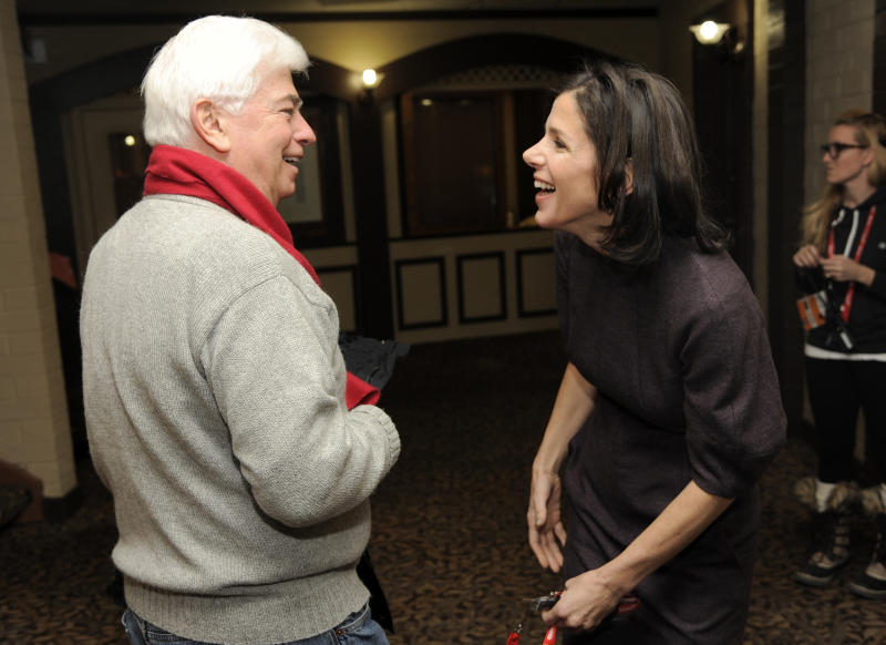 """Christopher Dodd, left, chairman and CEO of the Motion Picture Association of America, greets Alexandra Pelosi, director of HBO Documentary Films' """"Fall to Grace,"""" before a screening of the film at the 2013 Sundance Film Festival, Friday, Jan. 18, 2013, in Park City, Utah. (Photo by Chris Pizzello/Invision/AP)"""