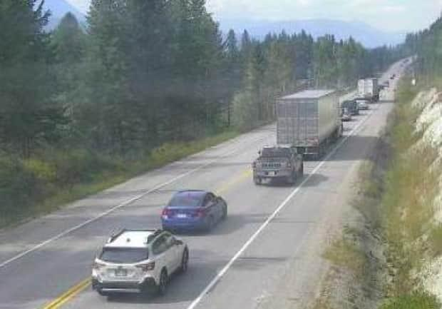 Cars are seen backed up on Highway 1 between Golden and Revelstoke, B.C. after a fatal crash that left one dead and four injured on Sept. 5, 2021. (DriveBC - image credit)