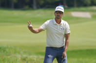 Roger Sloan acknowledges the crowd after making a birdie on the sixth hole during the third round of the 3M Open golf tournament in Blaine, Minn., Saturday, July 24, 2021. (AP Photo/Craig Lassig)