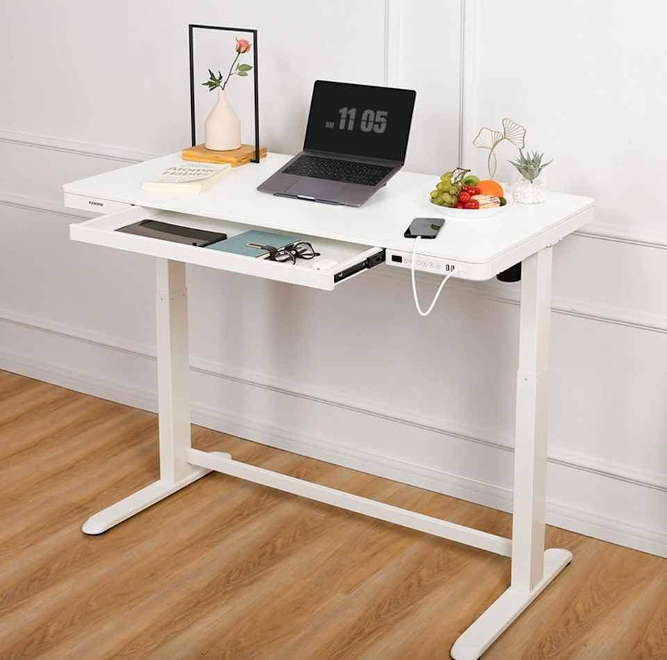 """<h2>Best Standing Desk Under $400</h2><br><h3>FlexiSpot Comhar All-in-One Standing Desk Wooden Top</h3><br><strong>The Hype:</strong> 5 out of 5 stars and 10 reviews on <a href=""""http://flexispot.com"""" rel=""""nofollow noopener"""" target=""""_blank"""" data-ylk=""""slk:FlexiSpot"""" class=""""link rapid-noclick-resp"""">FlexiSpot</a><br><br><strong>WFH Heroes Say:</strong> """"So happy with this desk! The maple chipboard is lovely and looks so nice in my space. Overall construction is very sturdy, assembly was a breeze straight out of the box, movement is smooth and quiet, and the built-in USB ports are super handy. My partner immediately said they wanted one too...I 100% recommend, this is a great price for such a solid, functional desk!""""<br><br><em>Shop</em> <strong><em><a href=""""http://flexispot.com"""" rel=""""nofollow noopener"""" target=""""_blank"""" data-ylk=""""slk:FlexiSpot"""" class=""""link rapid-noclick-resp"""">FlexiSpot</a></em></strong><br><br><br><strong>Flexispot</strong> Comhar All-in-One Standing Desk Wooden Top, $, available at <a href=""""https://go.skimresources.com/?id=30283X879131&url=https%3A%2F%2Fwww.flexispot.com%2Fcomhar-all-in-one-standing-desk-wooden-top-48-w"""" rel=""""nofollow noopener"""" target=""""_blank"""" data-ylk=""""slk:Flexispot"""" class=""""link rapid-noclick-resp"""">Flexispot</a>"""