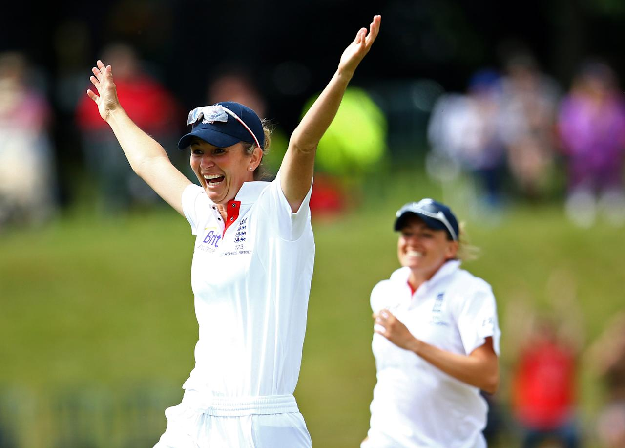 HIGH WYCOMBE, ENGLAND - AUGUST 14:  Charlotte Edwards, Captain of England celebrates the run out of Sarah Elliott of Australia by team-mate Lydia Greenway during day four of the Women's Ashes Series match between England and Australia at Wormsley Cricket Ground on August 14, 2013 in High Wycombe, England.  (Photo by Jan Kruger/Getty Images)