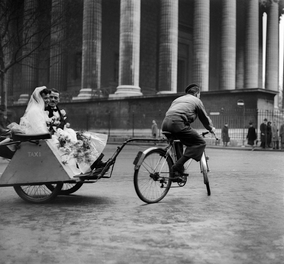 <p>Like the couple who rode to their wedding on donkeys, this Parisian couple in World War II France had to get creative with their transportation. Being in the city, they had another option: the pedicab. </p>