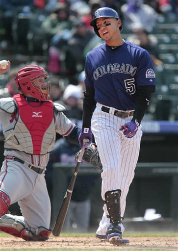 Colorado Rockies' Carlos Gonzalez (5) reacts to a strike call during the fifth inning of the first baseball game of a doubleheader against the Atlanta Braves, Tuesday, April 23, 2013, in Denver. (AP Photo/Barry Gutierrez)