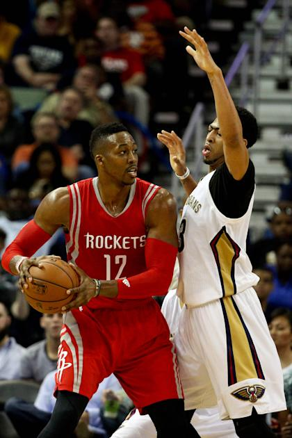 Mar 25, 2015; New Orleans, LA, USA; Houston Rockets center Dwight Howard (12) is defended by New Orleans Pelicans forward Anthony Davis (23) during the second half of a game at the Smoothie King Center. The Rockets defeated the Pelicans 95-93. (Derick E. Hingle-USA TODAY Sports)