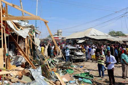 Civilians gather near the scene of a suicide bomb explosion at the Wadajir market in Madina district of Somalia's capital Mogadishu February 19, 2017. REUTERS/Feisal Omar