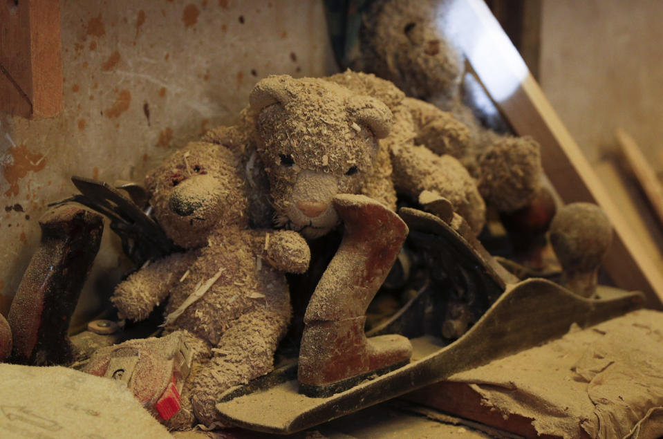 Teddy Bears covered in sawdust sit nex to tools at a family-run carpentry workshop in El Alto, Bolivia, Friday, Aug. 28, 2020. In Bolivia, the government decided to cancel the school year in August because it said there was no way to provide an equitable education to the country's nearly 3 million students. (AP Photo/Juan Karita)