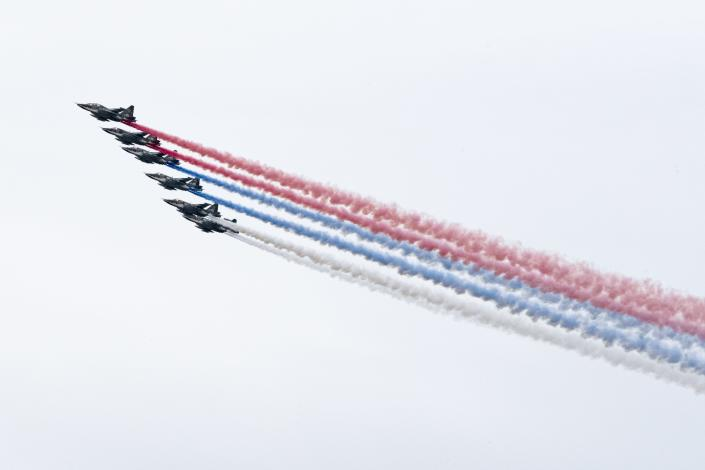 Russian warplanes fly over Red Square leaving trails of smoke in colors of national flag to mark the 75th anniversary of the Nazi defeat in World War II in Moscow, Russia, Saturday, May 9, 2020. A massive Victory Day parade on Red Square was cancelled due to the coronavirus outbreak, but Russia marked the holiday with the flyby. (AP Photo/Mikhail Kirakosyan)