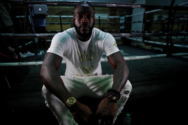 Heavyweight champion Deontay Wilder hopes that his story provides a beacon of hope for others. (Action Images via Reuters/Andrew Couldridge)