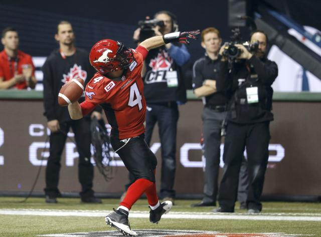 Calgary Stampeders' quarterback Drew Tate celebrates a touchdown against the Hamilton Tiger Cats in the first half during the CFL's 102nd Grey Cup football championship in Vancouver, British Columbia, November 30, 2014. REUTERS/Todd Korol (CANADA - Tags: SPORT FOOTBALL)