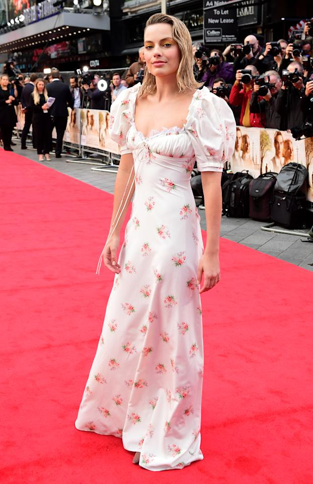 <p>Margot Robbie attended the London premiere of 'Goodbye, Christopher Robin' wearing a floral frock by US design duo Laura Vassar and Kristopher Brock. The vintage-inspired number featured billowing sleeves and a close-fitting waist. <br /><em>[Photo: PA]</em> </p>