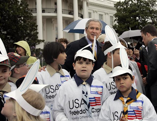 <p>President Bush poses with children during the annual Easter Egg Roll in Washington, Monday, April 17, 2006.The egg roll has been held at the White House since 1878, after a stint on the Capitol grounds. Thousands waited in long lines for the free tickets. (Photo: Gerald Herbert/AP) </p>