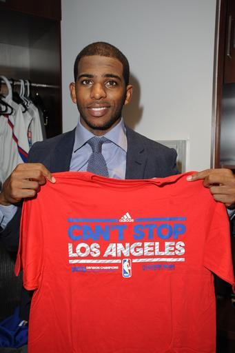 LOS ANGELES, CA - APRIL 7: Chris Paul #3 of the Los Angeles Clippers holds up a shirt recognizing that the Los Angeles Clippers are the Pacific Division champions after a game against the Los Angeles Lakers at Staples Center on April 7, 2013 in Los Angeles, California. (Photo by Andrew D. Bernstein/NBAE via Getty Images)