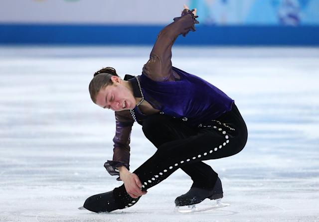 SOCHI, RUSSIA - FEBRUARY 13: Jason Brown of the United States competes during the Men's Figure Skating Short Program on day 6 of the Sochi 2014 Winter Olympics at the at Iceberg Skating Palace on February 13, 2014 in Sochi, Russia. (Photo by Robert Cianflone/Getty Images)