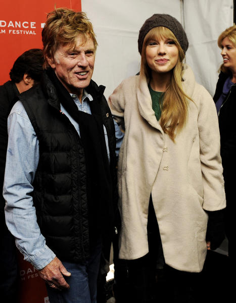 "FILE - In this Jan. 20, 2012 file photo, Robert Redford poses with singer Taylor Swift at the premiere of the documentary film ""Ethel"" at the 2012 Sundance Film Festival in Park City, Utah. (AP Photo/Chris Pizzello, File)"
