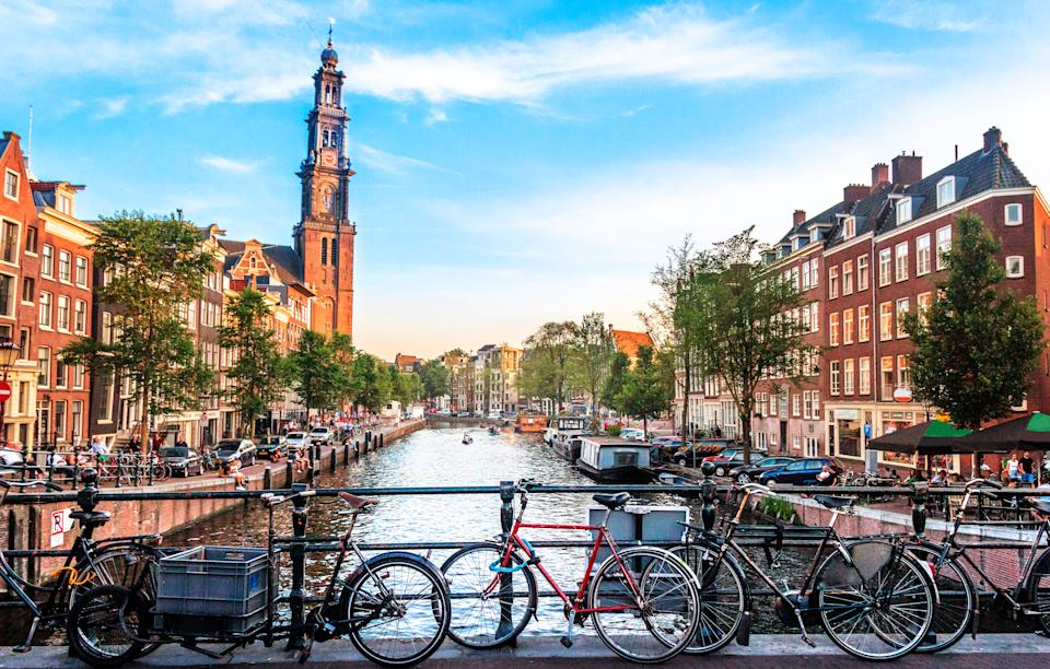 View of canal in Amsterdam, Holland. Amstel river, canal, and bicycles.