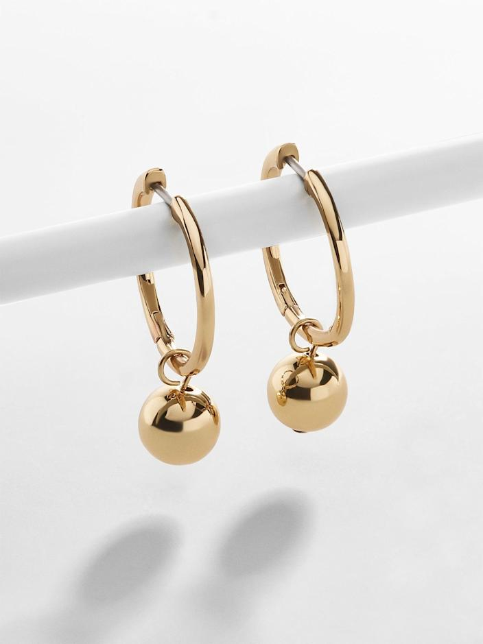 """<h3><a href=""""https://www.baublebar.com/product/48884-ball-huggie-hoops"""" rel=""""nofollow noopener"""" target=""""_blank"""" data-ylk=""""slk:BaubleBar Ball Huggie Hoops"""" class=""""link rapid-noclick-resp"""">BaubleBar Ball Huggie Hoops</a></h3><br>Whatever her personal style, these understated and delicate, hypoallergenic gold-plated huggie hoops are guaranteed to please. <br><br><strong>BaubleBar</strong> Ball Huggie Hoops, $, available at <a href=""""https://go.skimresources.com/?id=30283X879131&url=https%3A%2F%2Fwww.baublebar.com%2Fproduct%2F48884-ball-huggie-hoops"""" rel=""""nofollow noopener"""" target=""""_blank"""" data-ylk=""""slk:BaubleBar"""" class=""""link rapid-noclick-resp"""">BaubleBar</a>"""