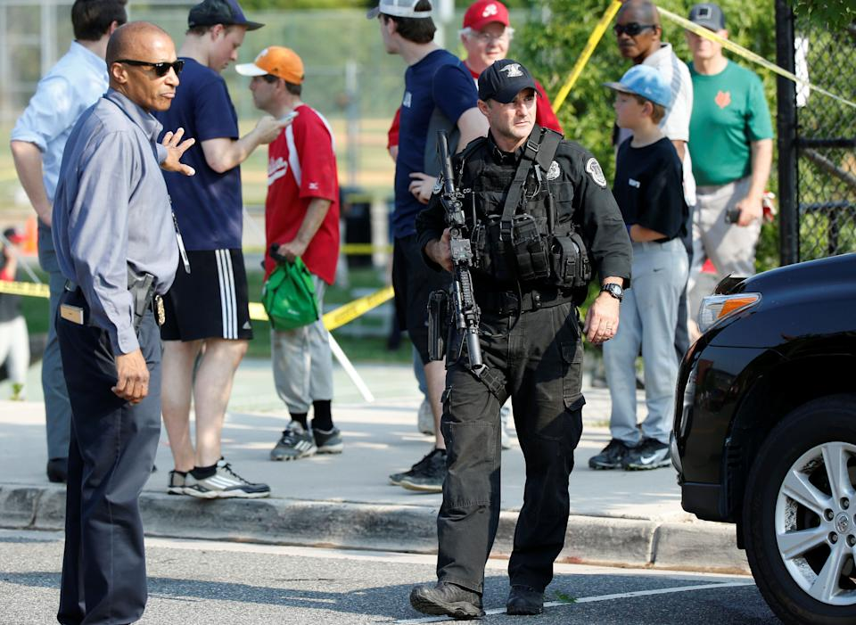 Police investigate a shooting scene after a gunman opened fire on Republican members of Congress during a baseball practice near Washington in Alexandria, Virginia, on June 14, 2017.