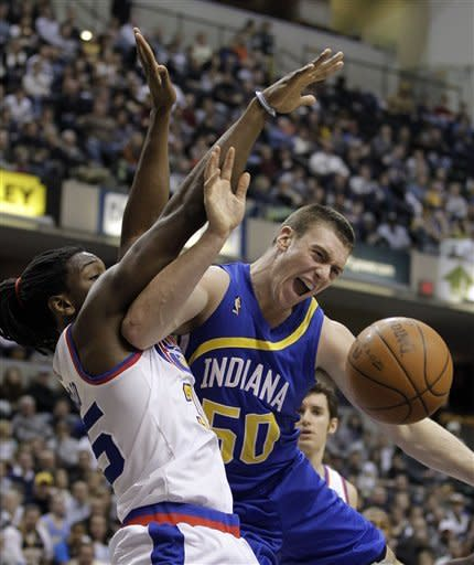 Indiana Pacers' Tyler Hansbrough (50) goes up against Denver Nuggets' Kenneth Faried during the second half of an NBA basketball game on Saturday, Feb. 11, 2012, in Indianapolis. Denver won 113-109. (AP Photo/Darron Cummings)