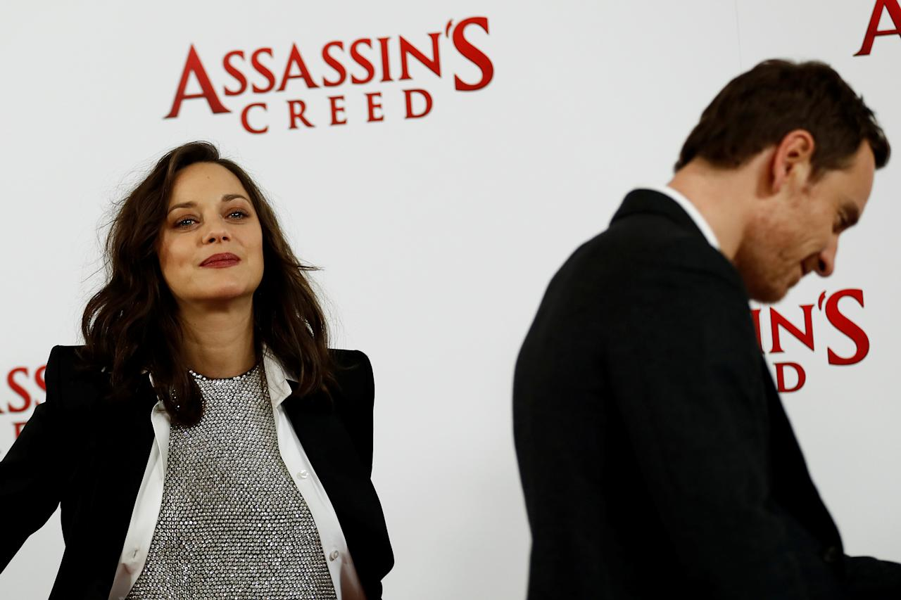 """Actors Marion Cotillard and Michael Fassbender pose during a photocall to promote the film """"Assassin's Creed"""" in London, Britain December 8, 2016.  REUTERS/Stefan Wermuth"""