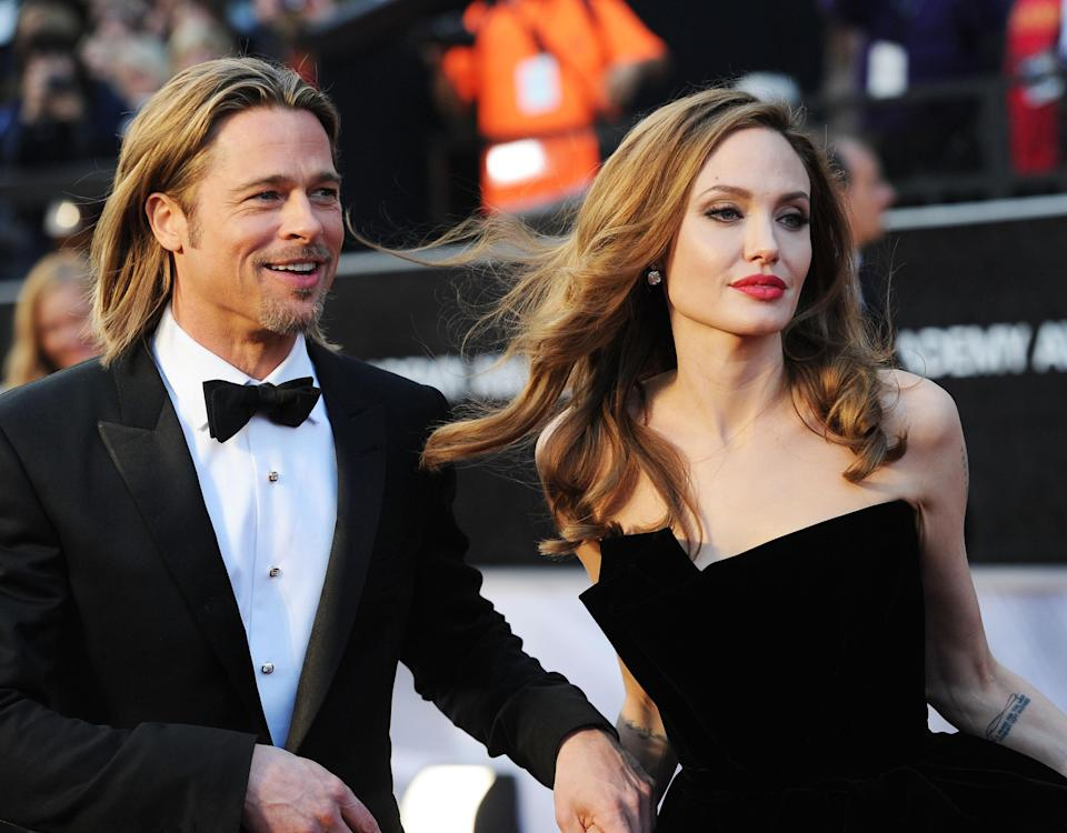 <p>Brad and Ange, who were married in 2014 and separated in 2016, arrived at the Oscars in 2012 – both looking windswept with flowing ombre waves. Photo: Getty Images </p>