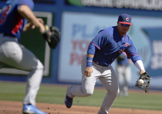 The Chicago Cubs' first baseman Daniel Vogelbach fields a ball during a spring exhibition baseball game against the New York Mets Sunday, March 16, 2014, in Las Vegas. (AP Photo/Isaac Brekken)