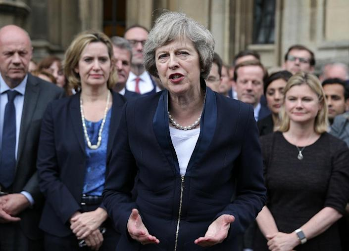 Britain's new Conservative Party leader Theresa May (C) speaks to members of the media in London on July 11, 2016 (AFP Photo/Daniel Leal-Olivas)