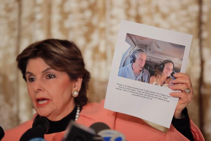 Attorney Gloria Allred holds a photograph of her client, Teala Davies with Jeffrey Epstein as she speaks in regards to a lawsuit alleging that Davies was assaulted by Jeffrey Epstein for two years during a press conference in New York City