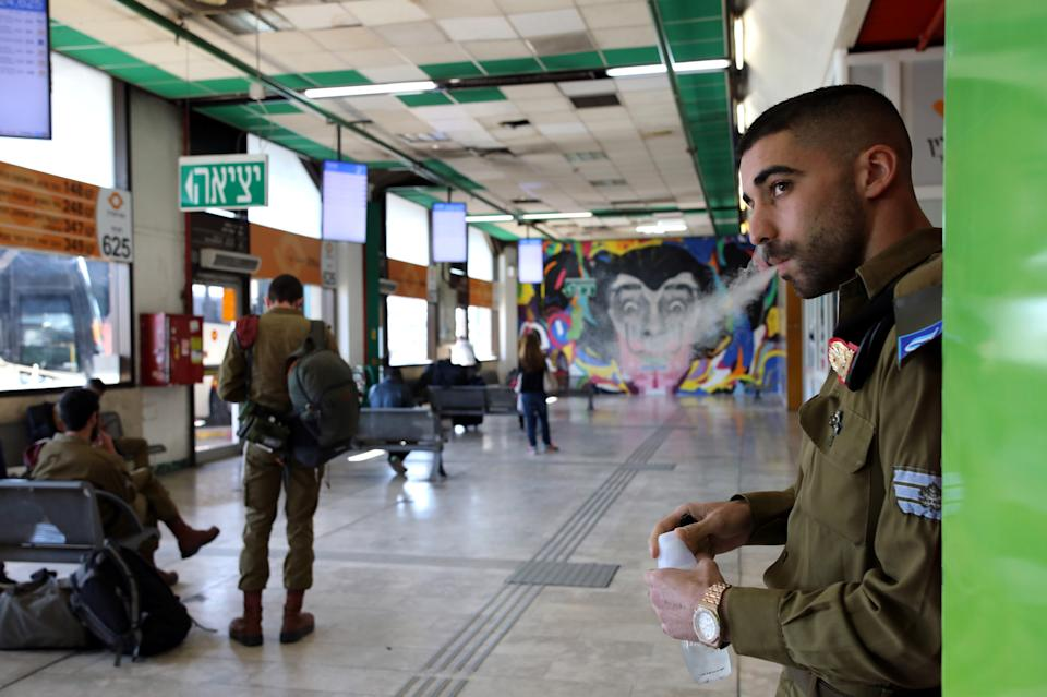 An Israeli soldier waits with others to board buses at the Central Bus Station on Feb. 3. (Photo: Corinna Kern/Reuters)