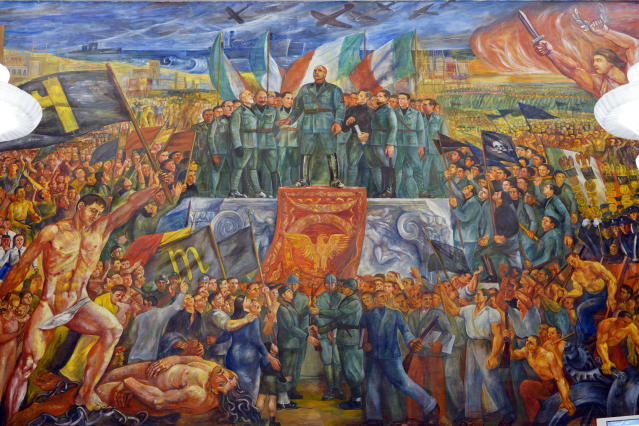 """A detail of the mural titled """"Apotheosis of Fascism"""", by Luigi Montanarini, believed to have been painted between the late1930's and early 1940's, in the Salone d'Onore of the CONI headquarters, in Rome, Tuesday, May 14, 2019. While Germany systematically wiped out traces of Adolf Hitler's Nazi regime after World War II, the legacy of his Axis ally, Benito Mussolini, remains present in Italy even today. (AP Photo/Andrew Medichini)"""