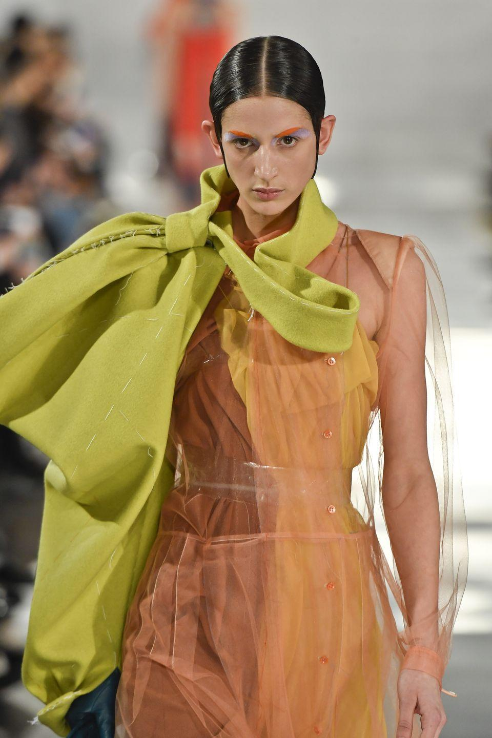 <p>There's never been a better time to dip a brush into the eyeshadow shades you usually eschew for neutrals. Check out the large swathes of bright color used at Maison Margiela.</p>