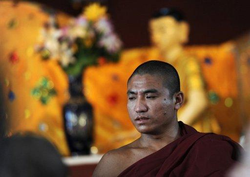 "<p>File photo of Gambira, while he was still a Buddhist monk at a monastery in Yangon on February 19, 2012. Gambira was serving a 68-year jail term for his role in the monk-led ""Saffron Revolution"" in 2007 until he was freed from jail along with hundreds of other political prisoners early this year.</p>"