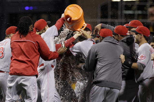 Cincinnati Reds starting pitcher Homer Bailey hugs Cincinnati Reds catcher Ryan Hanigan, center, as they are doused by Reds pitcher Bronson Arroyo, third from left, after getting the final out of a no-hitter in a baseball game against the Pittsburgh Pirates in Pittsburgh Friday, Sept. 28, 2012. The Reds won 1-0. (AP Photo/Gene J. Puskar)