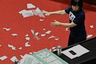 Lu Yu-ling from the KMT tears up ballots as the party protests against the Control Yuan nomination