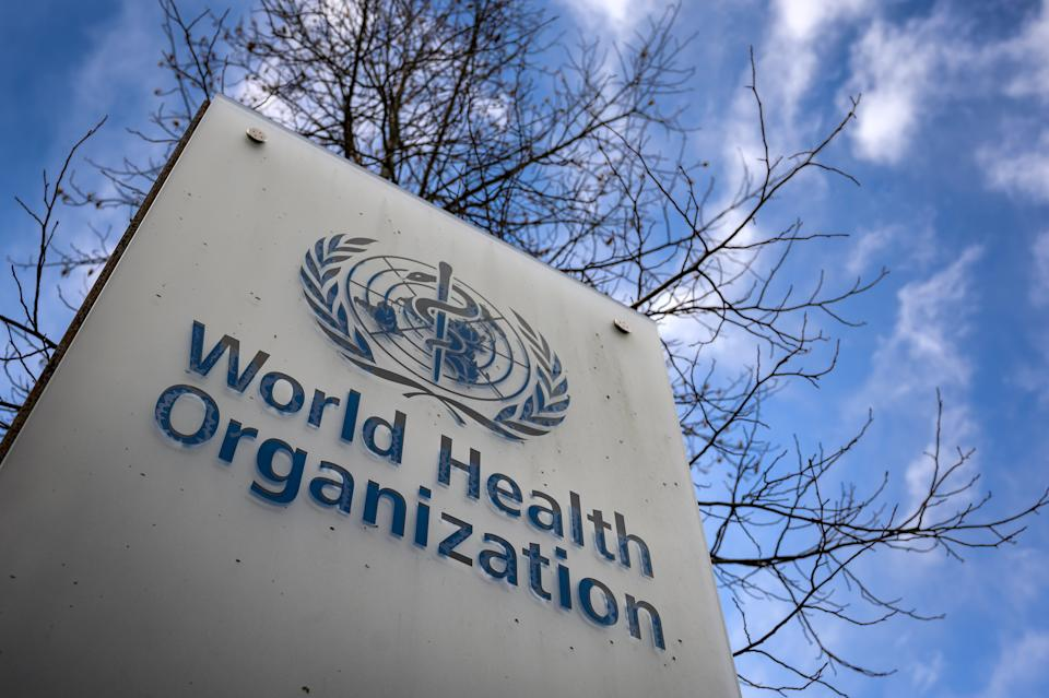 This photograph taken on January 29, 2021 shows a sign of the World Health Organization (WHO) at the entrance of their headquarters in Geneva amid the Covid-19 outbreak, caused by the novel coronavirus. (Photo by Fabrice COFFRINI / AFP) (Photo by FABRICE COFFRINI/AFP via Getty Images)